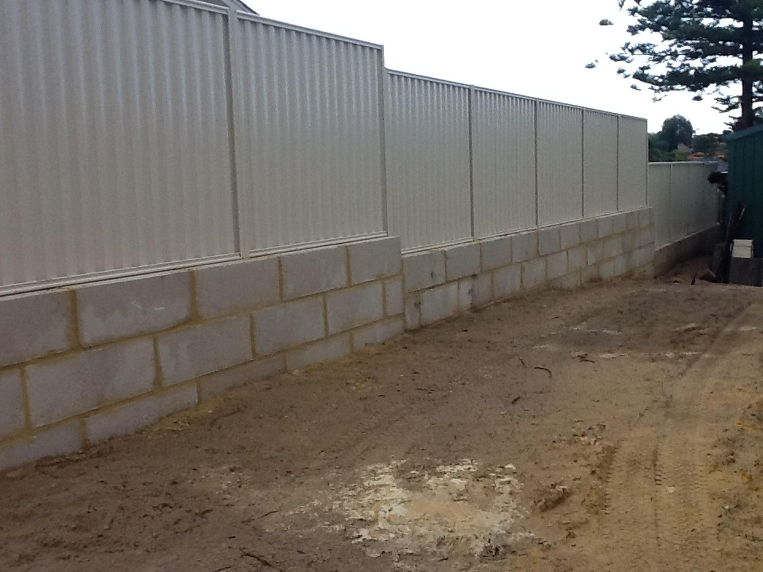 how to build a limestone block retaining wall