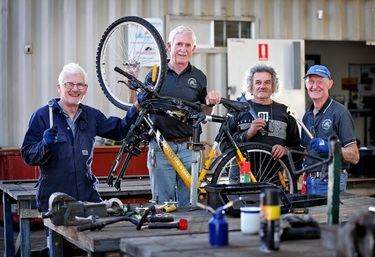 Volunteers change lives a bike at a time